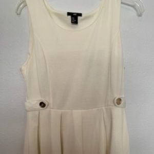 H&M Dresses - H&M White dress Plitted Bottom Size M
